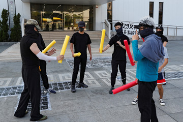 Masked participants hold foam sticks during a self-defence class organised by a student union at the Chinese University of Hong Kong, in Hong Kong, China