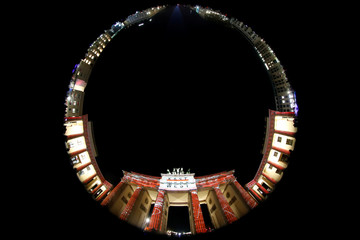 A fish-eye lens photograph shows the former East German site of the Brandenburg Gate during the Festival of Lights event at night in Berlin