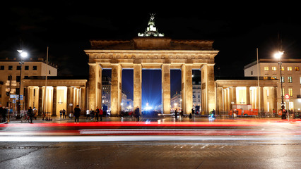 A long exposure picture shows a section of the Berlin Wall Trail in front of the Brandenburg Gate at night in Berlin