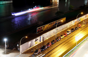 A long exposure picture shows a general view of the East Side Gallery at night in Berlin