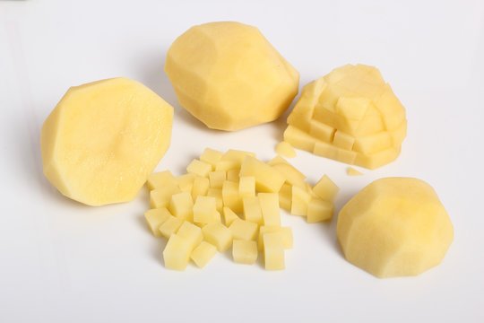 Raw diced peeled potatoes. Isolated with a white background.