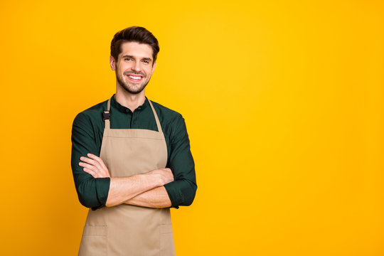 Photo of white cheerful positive man smiling toothily with arms crossed expressing positive emotions on face near empty space isolated bright color background