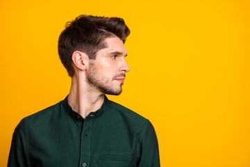 Profile side photo of serious concentrated guy look at copyspace hear work job problems want solve wear casual style outfit isolated over yellow color background Wall mural