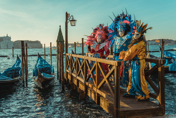 Poster Venetie Colorful carnival masks at a traditional festival in Venice, Italy