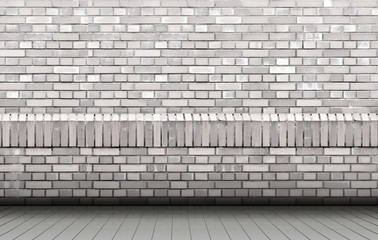 Gray brick wall of an old building. wooden light floor