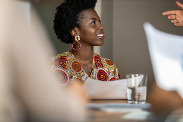 Fototapeta Beautiful young confident professional black african business woman smiling in meeting obraz