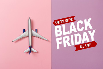 top view photo of toy airplane over color  background . Black friday sale