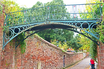 Erected in  1814 and named after the Mayor of the time, the Burnet Patch Bridge is a cast iron footbridge across a gap in the Exeter city walls.