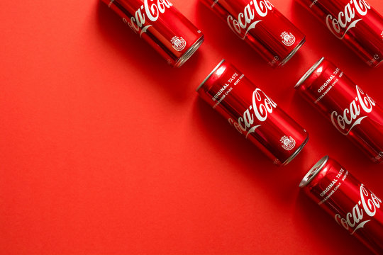 Close-up of Coca Cola drink jars lying on paper background.  Pattern. Top view.  Lvov, Ukraine - January 23, 2018.