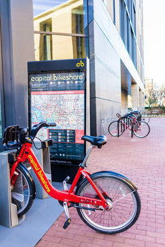 Washington DC, USA - March 4, 2017: Capital bikeshare sign with red bicycles