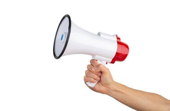Announcement concept. Shout It Out. Hand holds megaphone on white background.