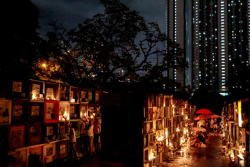 Filipinos visit their departed loved ones on All Saints Day at a public cemetery in Makati City