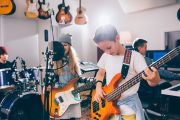 Young kids rock band in music studio