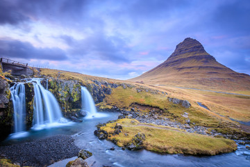Incredible Nature landscape of Iceland. Fantastic picturesque sunset over Majestic Kirkjufell (Church mountain) and waterfalls. Kirkjufell mountain, Iceland. Famous travel locations.. Fototapete