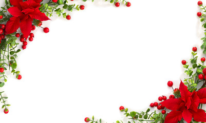 Papiers peints Fleuriste Christmas decoration. Frame of flower of red poinsettia, branch christmas tree, red berry on a white background with space for text. Top view, flat lay