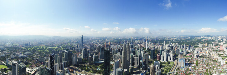 View from above, stunning panoramic view of the Kuala Lumpur skyline during a cloudy day. Kuala Lumpur commonly known as KL, is the national capital and largest city in Malaysia.