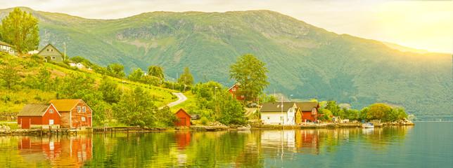 Deurstickers Noord Europa Village houses sea view, Norway. Norwegian fjords green landscape, Rosendal rural town.