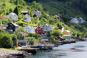 View of Ullensvang village on coasts of the Hardanger fjord, Hordaland county, Norway.