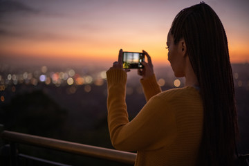Woman viewing panorama of a modern city