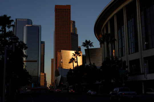 The skyline of the city's downtown is shown with the Walt Disney Concert Hall reflecting the morning sunrise in Los Angeles