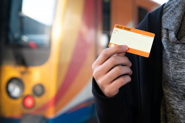 Hand holding one blank train ticket with europe train for travel and background concept. Blank ticket template.