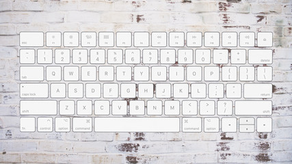 English computer keyboard layout on brick background