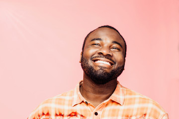 Portrait of a young man with big smile looking up, isolated on colorful background