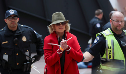 """Actress Jane Fonda is arrested by U.S. Capitol Police officers during a """"Fire Drill Fridays"""" climate change protest on Capitol Hill in Washington"""