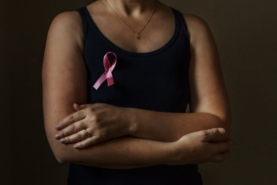October is breast cancer awareness month,a woman holds a pink ribbon to support people living and sick.Health, international women's day and the concept of the world day of fight against cancer.Noises