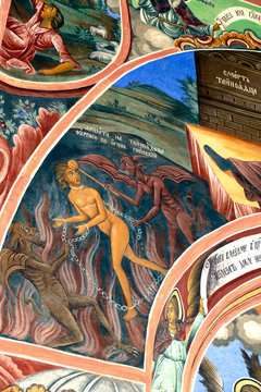 Exterior fresco paintings of sinners condemned to hell