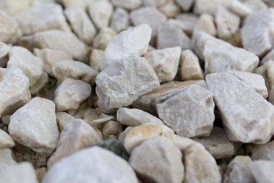 pile of stones pebble light grey texture background