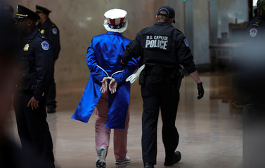 """Acitivist dressed as Uncle Sam is arrested during """"Fire Drill Fridays"""" climate change protest on Capitol Hill in Washington"""
