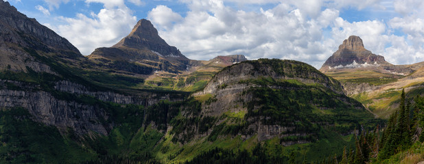 Wall Mural - Glacier National Park, Montana, United States. Beautiful Panoramic View of American Rocky Mountain Landscape during a Cloudy Summer Morning.