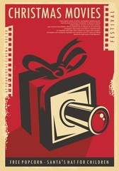 Christmas movies festival retro poster design with Christmas gift, film strips  and movie camera. Vintage vector illustration for cinema holiday event on red background and old paper texture.