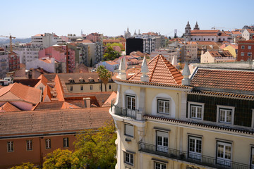 Tile rooftops on a sunny day in Lisbon, Portugal