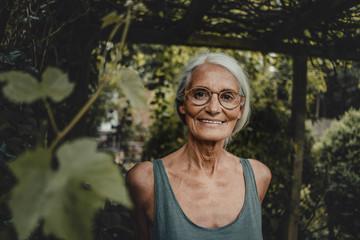 Portrait of a senior woman, wearing glasses