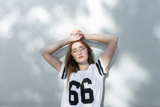 Portrait of young woman, wearing t-shirt with number 66