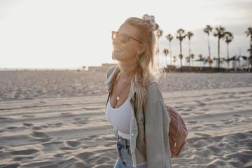 Happy young woman on the beach, Venice Beach, California, USA