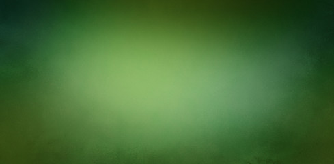 Wall Mural - Dark and light green background with soft blurred texture design, abstract blurry green Christmas background with light center and dark borders