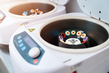 Blood test tubes in centrifuge. Plasma preparation in medical hematology laboratory concept - Stock photo