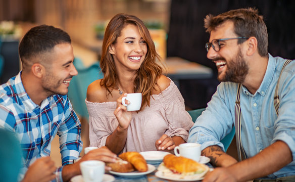 Group of friends having a coffee together