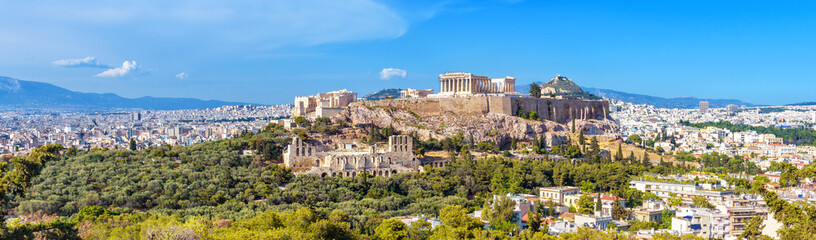 Wall Murals Athens Panorama of Athens with Acropolis hill, Greece. Famous old Acropolis is a top landmark of Athens. Landscape of the Athens city with classical Greek ruins. Scenic view of remains of ancient Athens.