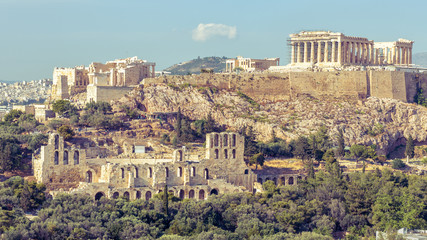 Fototapete - Acropolis with famous Parthenon, Athens, Greece. It is top landmark of Athens. View of remains of ancient Athens city. Urban landscape of old Athens with classical Greek ruins. Vintage style photo.