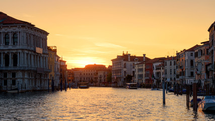 Fototapete - Venice at sunset, Italy. Panorama of the famous Grand Canal at night. Landscape of the Venice city in twilight. Scenery of sunny street in the Venice center at dusk. View of town in evening sunlight.