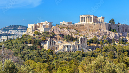 Fototapete Acropolis of Athens in summer, Greece. View of famous Parthenon and Odeon of Herodes. Urban landscape of old Athens with classical Greek ruins. Scenic panorama of remains of ancient Athens city.