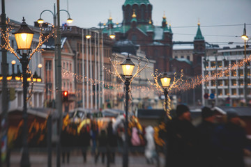 Christmas decorations in the historical center streets of Helsinki, with evening light illumination, concept of Christmas in Finland, with Cathedral, market square, christmas tree Fotomurales