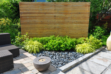 Printed roller blinds Gray traffic Beach pebbles, square cut flagstone and brick landscape pavers and simple plantings provide ample texture and contrast in this small contemporary backyard Asian inspired urban garden.