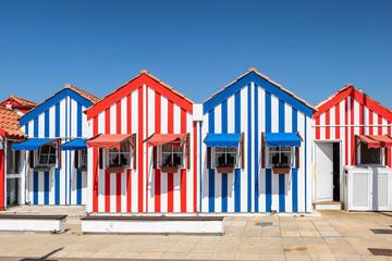 Colorful houses in Costa Nova, Aveiro, Portugal. Street with striped houses, Costa Nova, Aveiro, Portugal. Facades of colorful houses in Costa Nova, Aveiro, Portugal