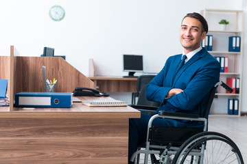 Young male employee in wheel-chair