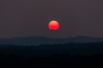 A vivid orange sun due to bushfire smoke in The Blue Mountains, New South Wales, Australia.